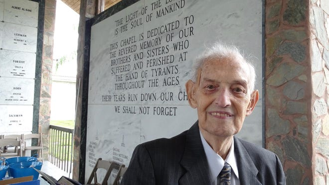 Holocaust survivor Norman Frajman spoke Monday at Eternal Light Memorial Gardens, west of Boynton. About 50 people joined there to commemorate International Holocaust Remembrance Day.