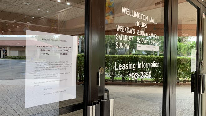 The original Wellington Mall at the corner of Wellington Trace and Forest Hill Boulevard in Wellington has scaled back its hours as officials work to slow the spread of the new coronavirus.