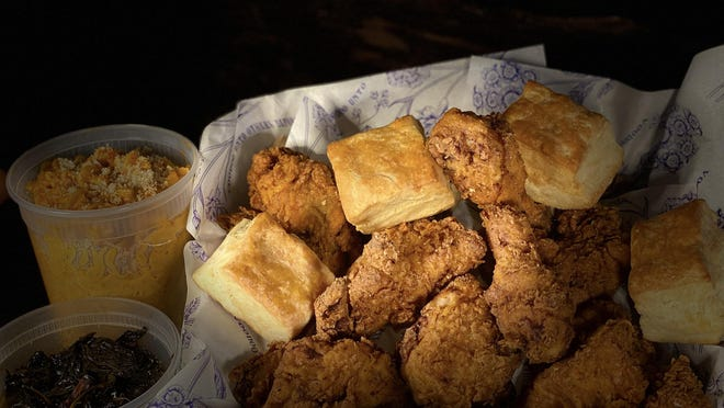"""Hot seller at Voodoo Bayou: Louisiana style fried chicken and buttermilk biscuits. The """"family meal"""" chicken order comes with smoky collards and mac and cheese. The New Orleans-themed restaurant is located in Palm Beach Gardens."""
