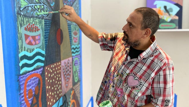 "Peruvian-born artist Renzo Ortega works on ""Transatlantic,"" one of two paintings dealing with cultural exchanges and commercial trade he's developing during his residency at Rosemary Square in West Palm Beach. Ortega is the New Wave Art Wknd's first artist in residence."