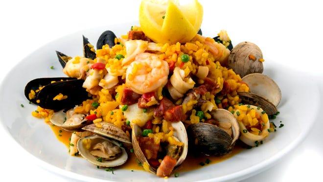Seafood paella at Lamoraga in Naples is prepared with traditional Spanish saffron rice and a selection of fresh seafood and chorizo. (Courtesy Lamoraga)