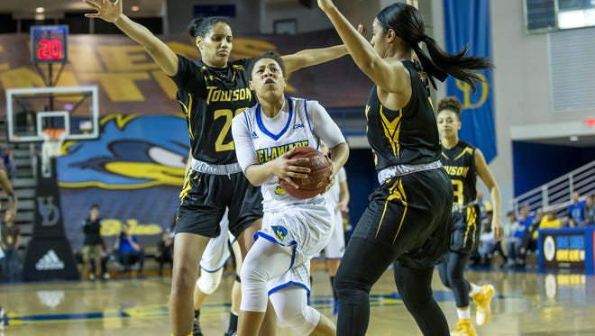 Erika Brown drives to the basket in Delaware's win over Towson Wednesday. She had 25 points.