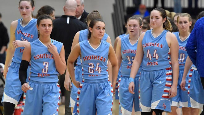 Southern Door players, from left, Meghan LaCrosse, Gabby Atkins, Jackie Atkins, Tehya Bertrand, Hailey Shimon and Grace LeGrave, walk off the floor after losing the Division 3 sectional championship game to Amherst on Saturday in Kaukauna.  Tina M. Gohr/USA TODAY NETWORK-Wisconsin