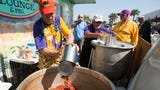 Watch Krewe of Wrecks serve up free bowls of red beans and rice to hundreds of people on Pensacola Beach.