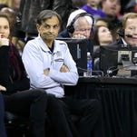 Sacramento Kings majority owner Vivek Ranadive, center, watches his team in a recent game.