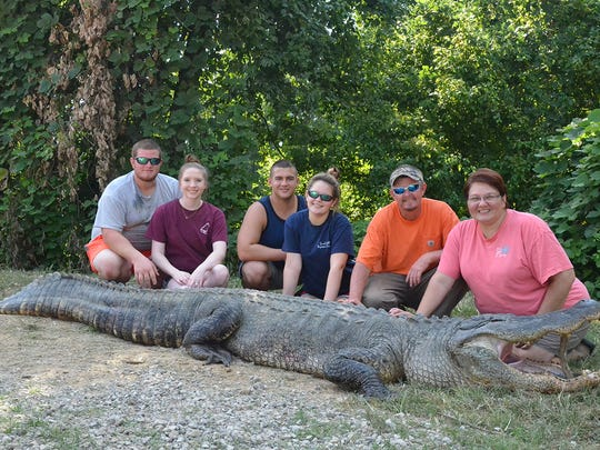 Hunters Destin Rivers, Landri Rivers, Jacob Lee, Kennedy Rivers, Ken Rivers, and Angelia Rivers, all of Ellisville, broke the alligator length record with this 13-foot, 7 3/4-inch giant.