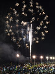 Thousands attend a fireworks display in Rehoboth Beach on Sunday. The event took about a year to plan.