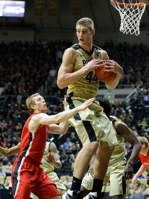 Purdue center Isaac Haas (44) grabs a rebound over Youngstown State guard Brett Frantz (15) in the first half of an NCAA college basketball game in West Lafayette, Ind., Saturday, Dec. 12, 2015. (AP Photo/Michael Conroy)