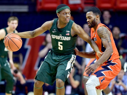 Michigan State guard Cassius Winston (5) looks for