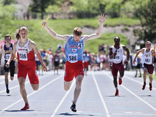 Lincoln senior Collin Brison celebrates the Patriots' win in the 4x100 relay.