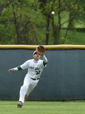 Spackenkill's Ryan Espinoza goes for a fly ball during Tuesday's game against Onteora.