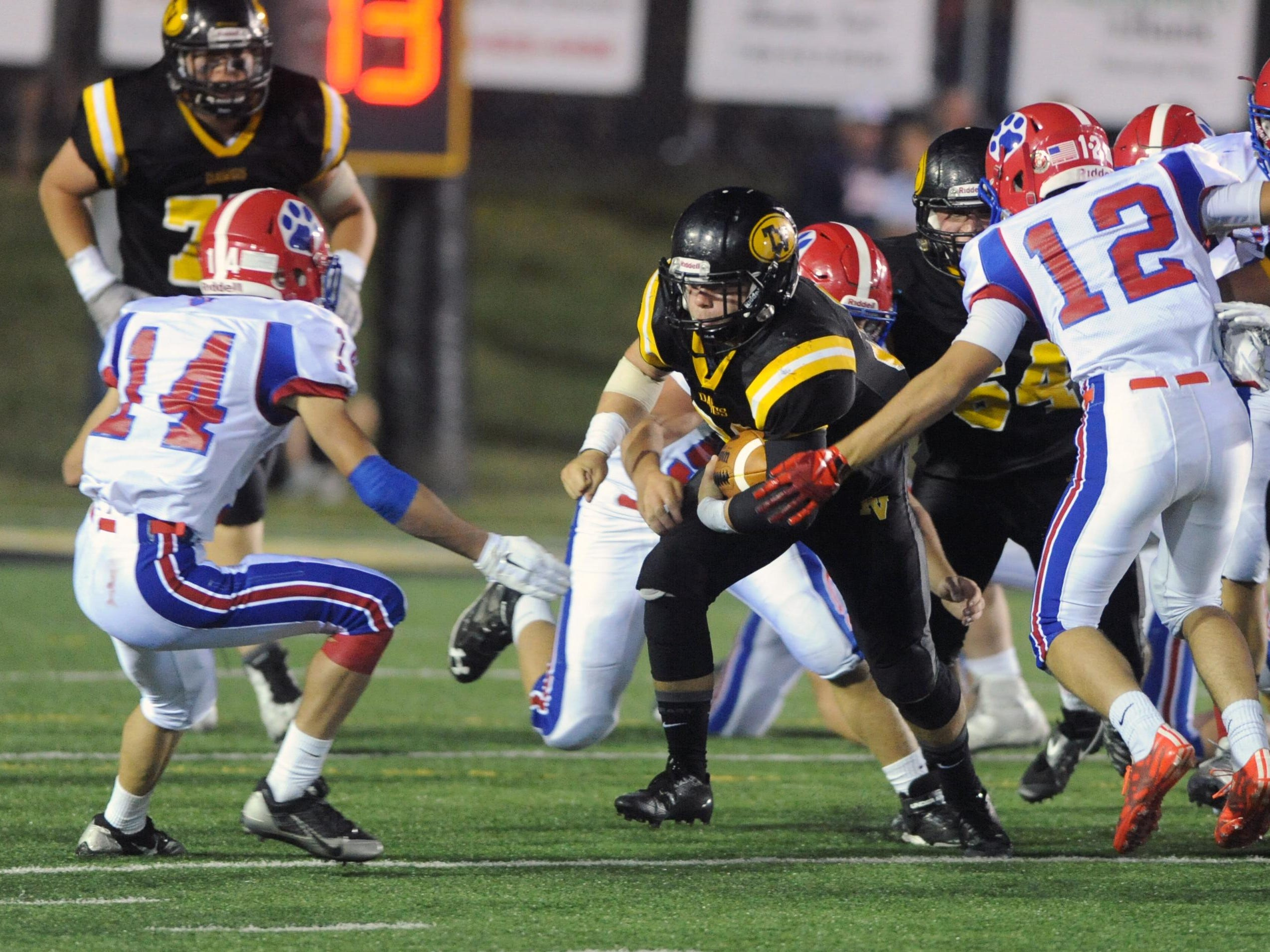 Tri-Valley's Cody Collins sheds tacklers as he bursts through the line during a game against Licking Valley on Friday in Dresden.
