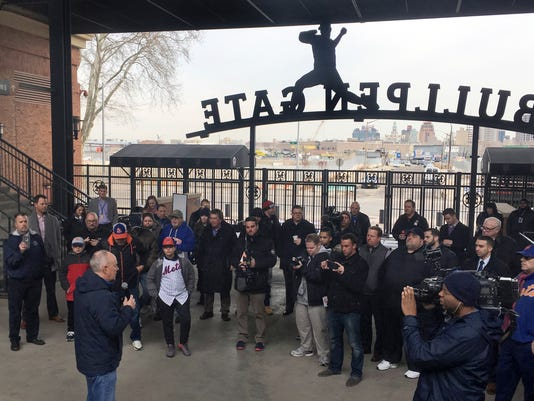 New York Mets general manager Sandy Alderson, left, speaks with fans at Citi Field, Thursday, Feb. 1, 2018, in New York, as the team's equipment truck left for spring training. (AP Photo/Ron Blum)