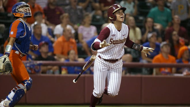 FSU's Alex Powers wathces her walk-off home run in their extra-inning, 3-1 win over Florida in front of a record crowd at JoAnne Graf Field on Wednesday.
