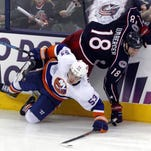 Columbus' R.J. Umberger (18) collides with New York Islanders' Casey Cizikas during the third period of Sunday's game.