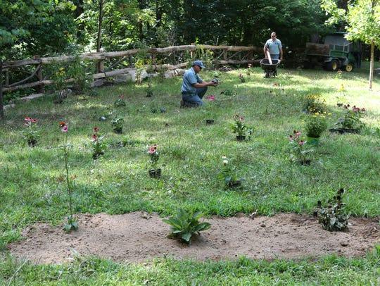 Ramon Acosta and Helio De Moraes plant perennial flowers