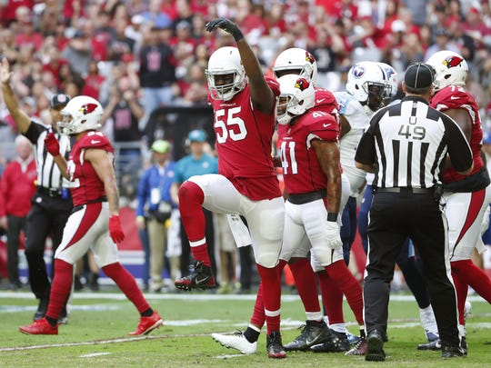 Cardinals linebacker Chandler Jones high-steps after