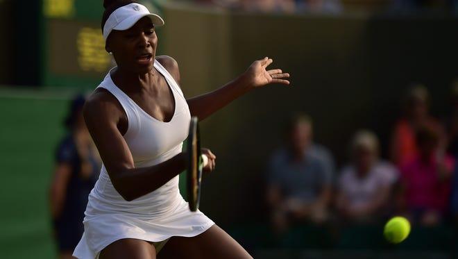 U.S. player Venus Williams returns to Kazakhstan's Yulia Putintseva.