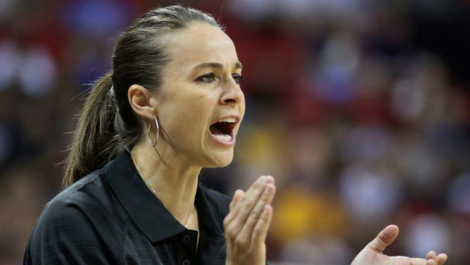 FILE - In this July 11, 2015 file photo, Becky Hammon coaches the San Antonio Spurs during an NBA summer league basketball game against the New York Knicks in Las Vegas.  Hammon plans to interview for the Milwaukee Bucks' coaching job, a person familiar with the search told The Associated Press. The person requested anonymity because the team does not comment on potential candidates. A woman has never been a head coach in the NBA. Hammon is the first female assistant in the league. (AP Photo/Ronda Churchill, File) ORG XMIT: NYCD501