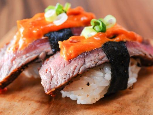 New York steak nigiri sushi prepared at the 9th Street