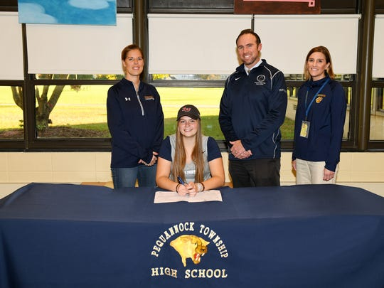 Pequannock High School senior lacrosse standout Jenny Soriero, center, committed to Liberty University last week with (L-R): coach Lindsay Lafferman, assistant principal/Athletic Director Michael Bouroult and Principal Alicia Scelso by her side.