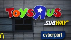 "A shopping mall that includes a Toys ""R"" Us store stands"