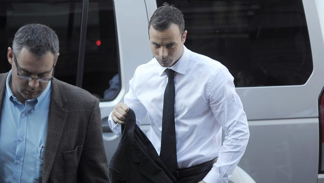 Oscar Pistorius arrives for his trial at the North Gauteng High Court in Pretoria on April 11.