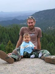 Nicholas Lewis' and his son are at Lookout Mountain