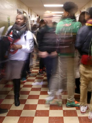 Students move through a hallway between classes at Jackson Central-Merry High School on Monday.
