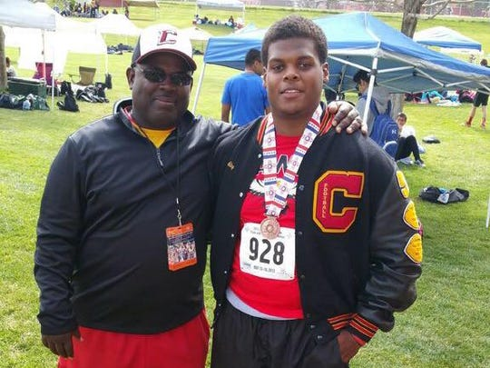 Centennial High School assistant football coach Roger Grays, left, poses with his nephew, Cameron Burkley.