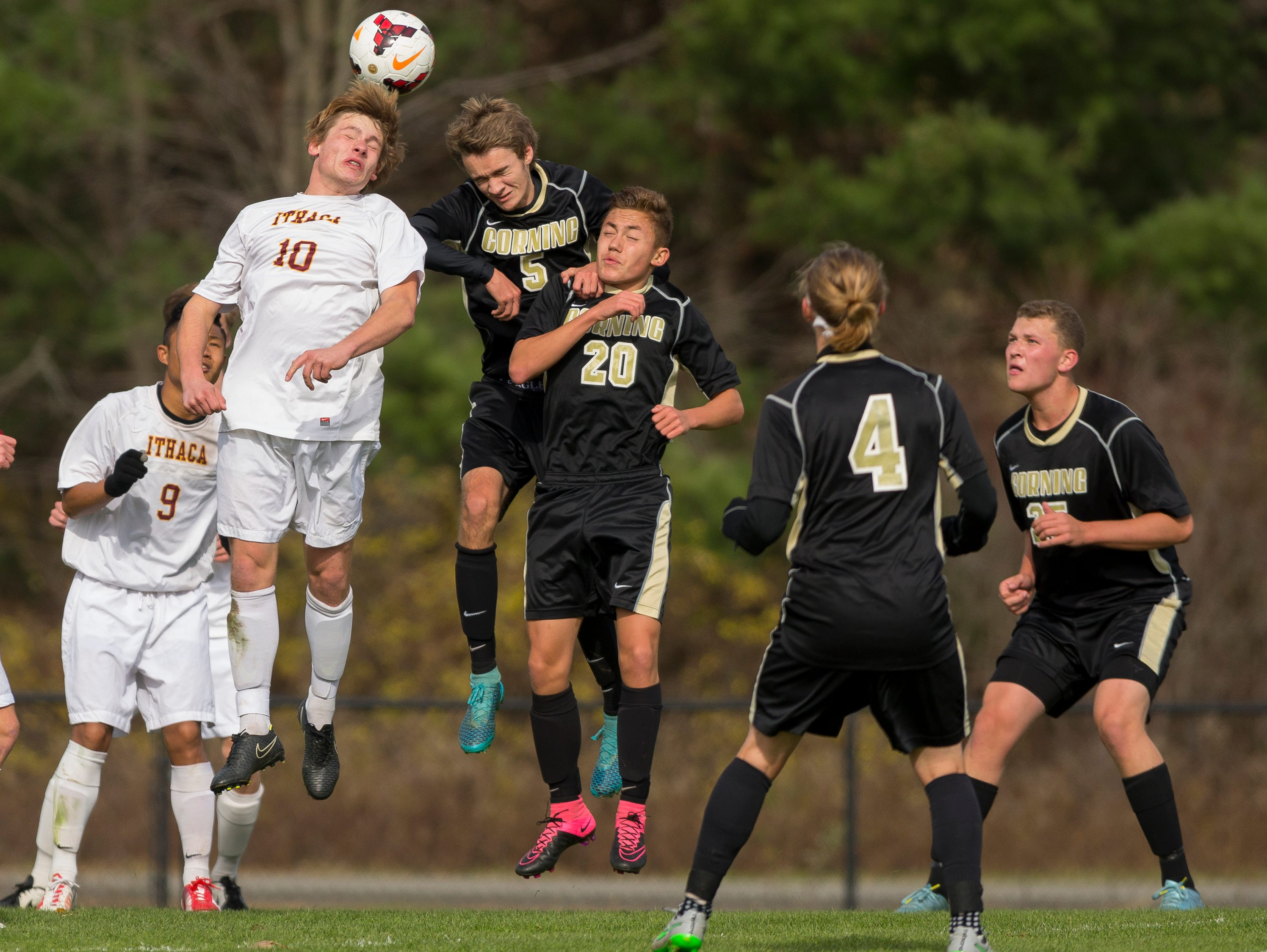 From left, Ithaca's Phyo Zay Htet, watches as Jared Brooks, and Corning's Trevor Kohli and Connor Lin battle for a ball Saturday during Ithaca's 2-0 win in the Section IV Class AA game in Oneonta.