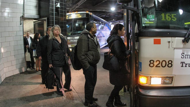 New Jersey-bound commuters board an NJ Transit bus at the Port Authority Bus Terminal in midtown Manhattan last year.