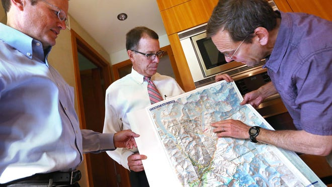 David Carter (right) points out the location where he and other climbers were when a deadly earthquake struck Nepal in April. Carter, John Mead (left) and Ace Yakey talked about their experience in Carter's Northside Indianapolis home on Tuesday, May 5, 2015.
