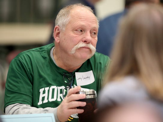 Larry Laraby listens to the discussion at his table