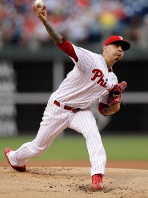 Philadelphia Phillies' Vince Velasquez pitches during the first inning of a baseball game against the New York Mets. He left after the first inning because of an injury to his right middle index finger.