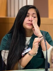 Jezzamay Arline Atherton weeps on the witness stand