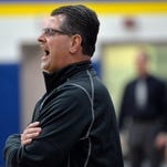St. Cloud Apollo head coach Dean Kesler yells instructions to his players during the first half  of a game on Dec. 23 at Cathedral High School.