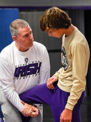Father Ryan wrestling coach Patrick Simpson works with