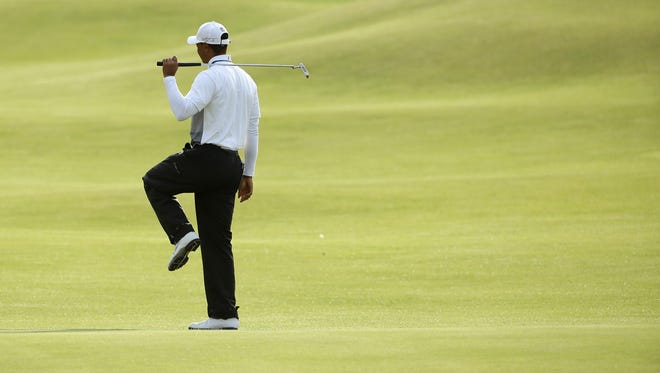 United States' Tiger Woods reacts as his putt fails to hole on the 18th green during the second round of the British Open Golf Championship at the Old Course, St. Andrews, Scotland, Saturday, July 18, 2015.