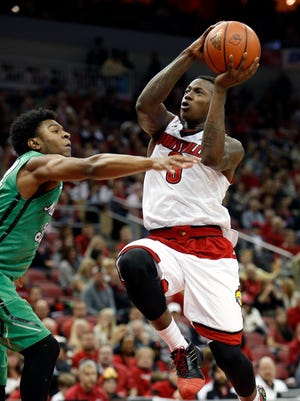 Louisville's Terry Rozier goes up for the layup against Marshall's Tamron Manning. 