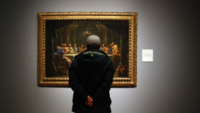 "A man stops to take a look at a painting called ""The Last Supper"" by Jean-Baptiste Champaigne while touring the Detroit Institute of Arts."