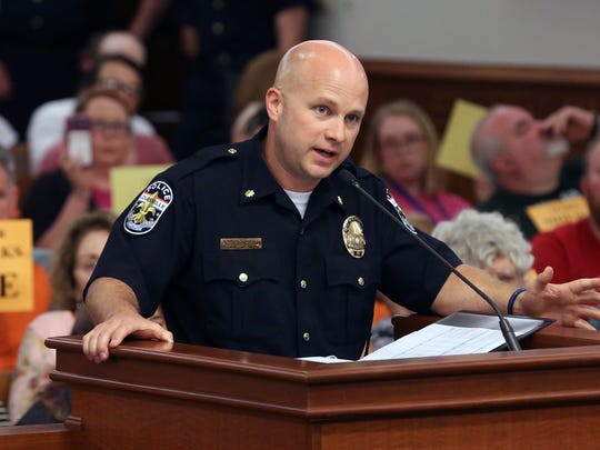 LMPD Major Eric Johnson speaks to members of the Metro Council Public Safety Committee on Wednesday afternoon.