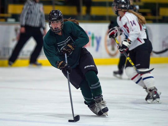 Vermont forward Jessica Scott of Spaulding races in