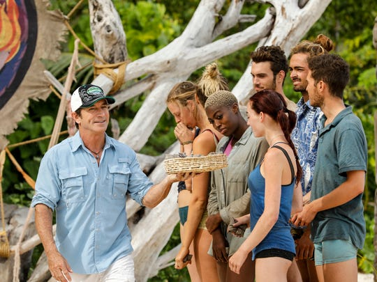 From left, Jeff Probst passes out new tribe buffs to Kellyn Bechtold, Desiree Afuye, Chelsea Townsend, Michael Yerger, Sebastian Noel and Bradley Kleihege.
