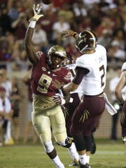 FSU's Josh Sweat tries to block the pass of Texas State quarterback Tyler Jones during their game at Doak Campbell Stadium on Saturday.