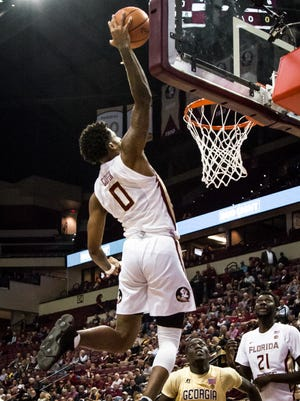 Phil Cofer (0) goes for the alleyoop slam against Georgia Tech as the FSU Men's Basketball team finishes the half up 50-36 on Wed., Jan 24th at the Donald L. Tucker Center.