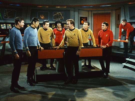 "Deforest Kelley, from left, Leonard Nimoy, Walter Koenig, Nichelle Nichols, Williams Shatner, George Takei, James Doohan and an unidentified actor appear in a scene from the television series ""Star Trek."""