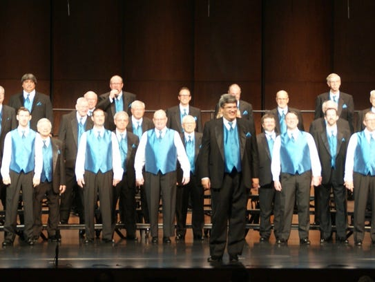 The Clipper City Chordsmen on stage at district competition