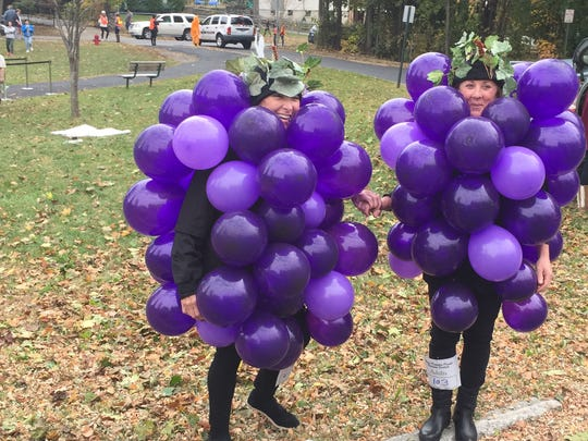 Grace Smith House board member Kathy Finn, left, and board chairwoman Barbara Mauri get ready for the domestic violence shelter's Halloween parade in the City of Poughkeepsie on Sunday, Oct. 30, 2016.