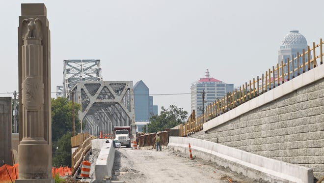 """Work continues on the Clark Memorial Bridge, which could open earlier than expected next week. Work is expected to continue into the middle of next year on a new """"flyover"""" ramp that will carry northbound traffic from U.S. 31 to Interstate 65. Aug. 5, 2014 By Matt Stone/The Courier-Journal"""
